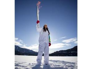The Olympic Torch - held by the first Torchbearer selected, Patricia Moreno.
