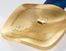 Reverse side of the Paralympic medals, including braille.