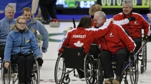 Team Canada's Paralympic Curling Team, winner's of the first-ever World Wheelchair Curling championship - photo by Darryl Dyck, The Canadian Press.