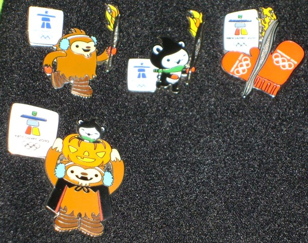 The Torch Relay pins (apparently one more to come) and this year's Halloween Pin (I'm going to set up somewhere to take better pin photos soon :) ).