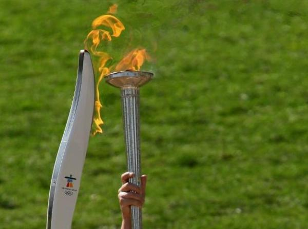The first Vancouver 2010 Torch being lit in Olympia!